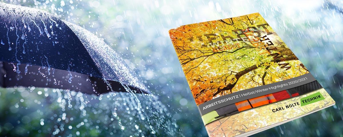 Schirm im Regen, Broschüre mit Herbstmotiv in gelb-orange-Tönen